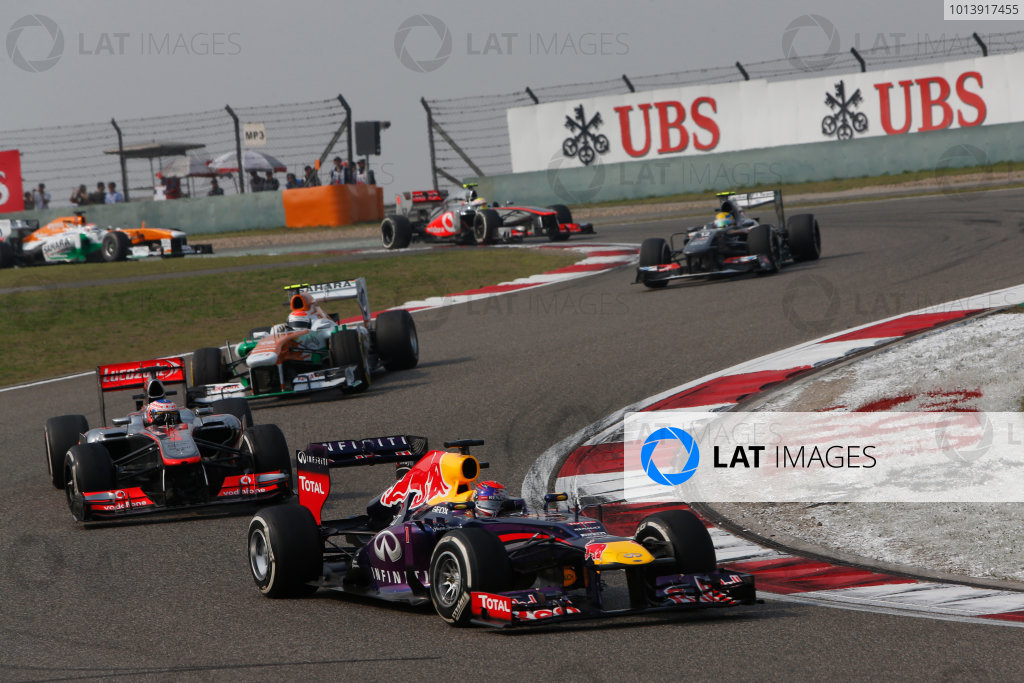 Shanghai International Circuit, Shanghai, China Sunday 14th April 2013 Sebastian Vettel, Red Bull RB9 Renault, leads Jenson Button, McLaren MP4-28 Mercedes, and Adrian Sutil, Force India VJM06 Mercedes.  World Copyright: Alastair Staley/LAT Photographic ref: Digital Image _R6T1724