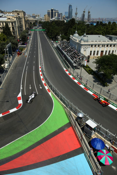 Baku City Circuit, Baku, Azerbaijan. Friday 23 June 2017. Lance Stroll, Williams FW40 Mercedes, and Max Verstappen, Red Bull Racing RB13 TAG Heuer, on opposite sections of the circuit. World Copyright: Charles Coates/LAT Images ref: Digital Image AX0W5132