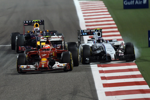 Kimi Raikkonen (FIN) Ferrari F14 T, Valtteri Bottas (FIN) Williams FW36 and Sebastian Vettel (GER) Red Bull Racing RB10 battle. Formula One World Championship, Rd3, Bahrain Grand Prix, Race, Bahrain International Circuit, Sakhir, Bahrain, Sunday 6 April 2014. BEST IMAGE