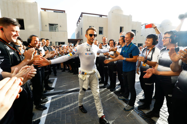 Yas Marina Circuit, Abu Dhabi, United Arab Emirates. Sunday 27 November 2016. Jenson Button, McLaren, walks to the garage to start his final race to the cheers and applause of his team. World Copyright: Steven Tee/LAT Photographic ref: Digital Image _O3I3387