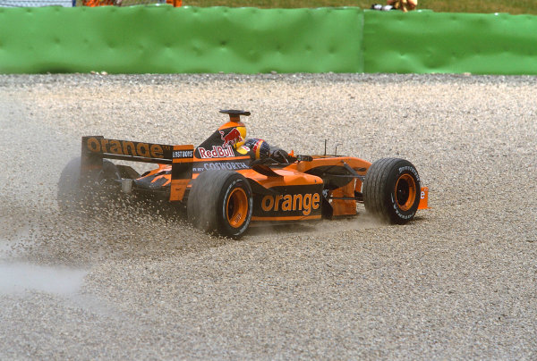 2002 Austrian Grand Prix.A1-Ring, Zeltweg, Austria.10-12 May 2002.Heinz-Harald Frentzen (Arrows A23 Cosworth) goes through the gravel trap after being hit by a B.A R. at the start.Ref-02 AUT 06.World Copyright - LAT Photographic