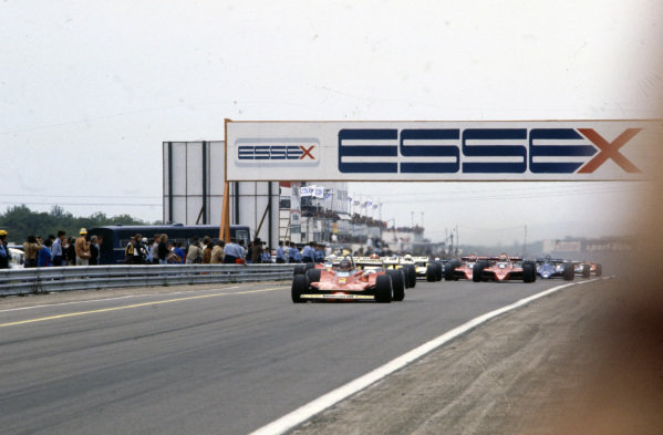 Gilles Villeneuve, Ferrari 312T4 gets ahead of pole sitter Jean-Pierre Jabouille, Renault RS10 at the start.