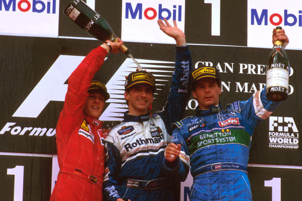Imola, Italy.3-5 May 1996.Damon Hill (Williams Renault) 1st position, Michael Schumacher (Ferrari) 2nd position and Gerhard Berger (Benetton Renault) 3rd position celebrate on the podium.Ref-96 SM 01.World Copyright - LAT Photographic