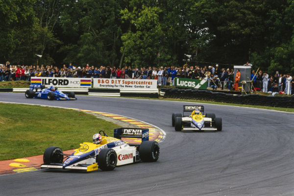 Nigel Mansell, Williams FW10 Honda, leads Keke Rosberg, Williams FW10 Honda, and Philippe Streiff, Ligier JS25 Renault.