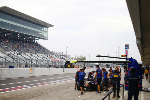 Fans in the grandstand watch Brendon Hartley, Toro Rosso STR13 Honda, in the pit lane