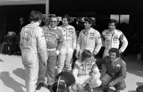 """L to r, back row: Elio de Angelis, Vittorio Brambilla, Riccardo Patrese, Giacomo Agostini, Bruno Giacomelli. Front row: Beppe Gabbiani, """"Gimax""""."""