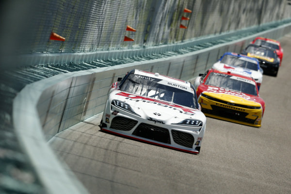Harrison Burton, Joe Gibbs Racing Toyota DEX Imaging, leads a pack of cars, Copyright: Michael Reaves/Getty Images.