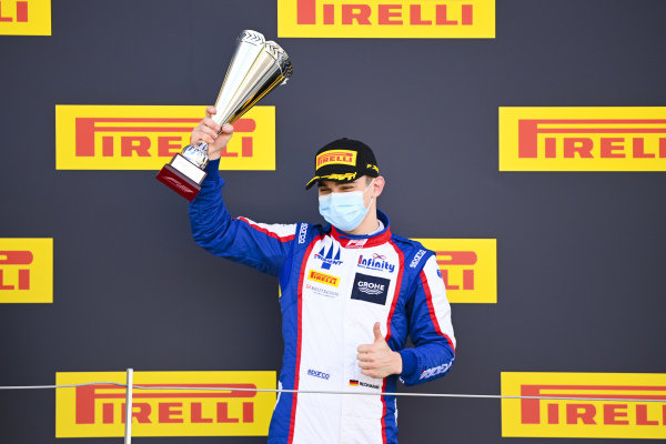 David BECKMAN (DEU, TRIDENT MOTORSPORT) celebrates on the podium with the trophy