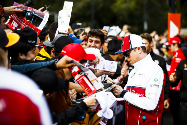 Kimi Raikkonen, Alfa Romeo Racing signs a autograph for a fan at the Federation Square event