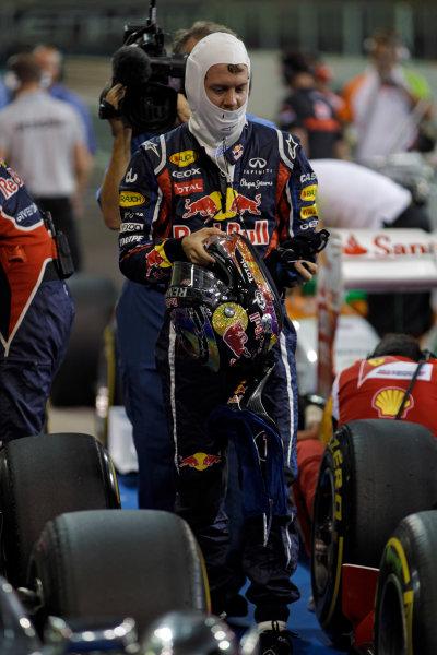 Yas Marina Circuit, Abu Dhabi, United Arab Emirates12th November 2011.Sebastian Vettel, Red Bull Racing RB7 Renault, celebrates pole in Parc Ferme. Portrait. Helmets. World Copyright:Glenn Dunbar/LAT Photographic ref: Digital Image _G7C4535