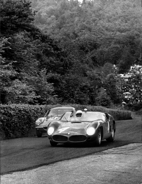 Nurburgring, Germany. 28th May 1961. RD 3. Richie Ginther/Olivier Gendebien/Wolfgang von Trips (Ferrari Dino 246SP), 3rd position, passes Edward Greenall/Ian B. Baillie (Lotus Elite), retired, action.  World Copyright: LAT Photographic. Ref:  B/WPRINT.