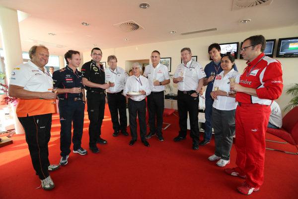 (L to R): Robert Fearnley (GBR) Force India F1 Team, Christian Horner (GBR) Red Bull Racing Team Principal, Eric Boullier (FRA) Lotus F1 Team Principal, Norbert Haug (GER) Mercedes Sporting Director, Martin Whitmarsh (GBR) McLaren Chief Executive Officer, Toto Wolff (AUT) Williams Executive Director, Monisha Kaltenborn (AUT) Sauber Team Prinicpal and Stefano Domenicali (ITA) Ferrari General Director toast Bernie Ecclestone (GBR) CEO Formula One Group (FOM) on his 82nd Birthday. Formula One World Championship, Rd17, Indian Grand Prix, Buddh International Circuit, Greater Noida, New Delhi, India, Race, Sunday 28 October 2012.