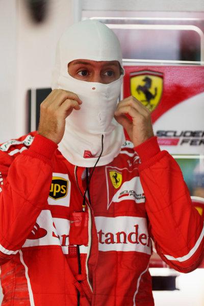 Sepang International Circuit, Sepang, Malaysia. Saturday 30 September 2017. Sebastian Vettel, Ferrari, puts on his balaclava before FP3. World Copyright: Zak Mauger/LAT Images  ref: Digital Image _56I0328