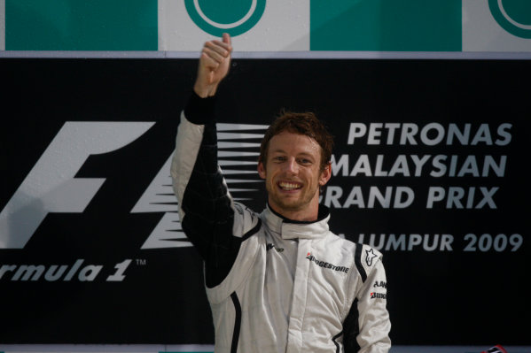 Sepang, Kuala Lumpur, Malaysia 5th April 2009 Jenson Button, Brawn GP BGP001 Mercedes, 1st position, celebrates on the podium. Portrait. Podium.  World Copyright: Andrew Ferraro/LAT Photographic ref: Digital Image _H0Y1284
