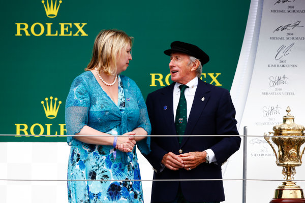 Silverstone, Northamptonshire, UK.  Sunday 16 July 2017. Sir Jackie Stewart on the podium with Karen Bradley MP, Secretary of State for Digital, Culture, Media and Sport.  World Copyright: Andy Hone/LAT Images  ref: Digital Image _ONZ7232