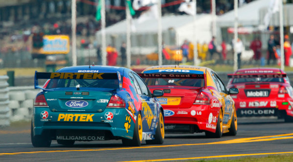 2003 Australian V8 Supercars, Round 9, Sandown, 14th September 2003.FORD Falcon BA drivers Marcos Ambrose and Russell Ingall in action during the Betta Electrical 500 held at Melbournes Sandown International Raceway today.Photo: Mark Horsburgh/LAT Photographic