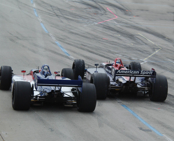 ChampCar Series Long Beach Grand Prix Priority11-13 April 2003 Long Beach, CaRyan Hunter-Rey nudges over Darren Manning as they leave the pits.2003- Dan R. Boyd USA LAT Photography