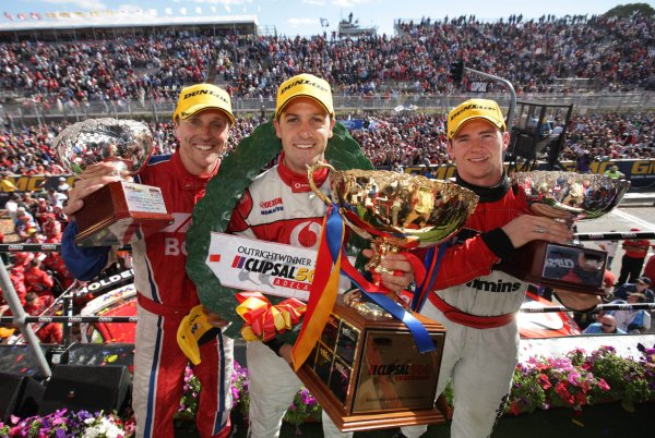 Jamie Whincup of the Triple Eight Racing team poses with Cameron McConville (L) and Lee Holdsworth (R) pose with their trophies after the Clipsal 500, Round 01 of the Australian V8 Supercar Championship Series at the Adelaide Street Circuit, Adelaide, South Australia, February 24, 2008. Whincup won the race with Holdsworth second and McConville third.