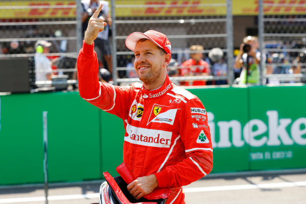 Autodromo Hermanos Rodriguez, Mexico City, Mexico. Saturday 28 October 2017. Sebastian Vettel, Ferrari, celebrates pole position on the grid. World Copyright: Steven Tee/LAT Images  ref: Digital Image _R3I5411