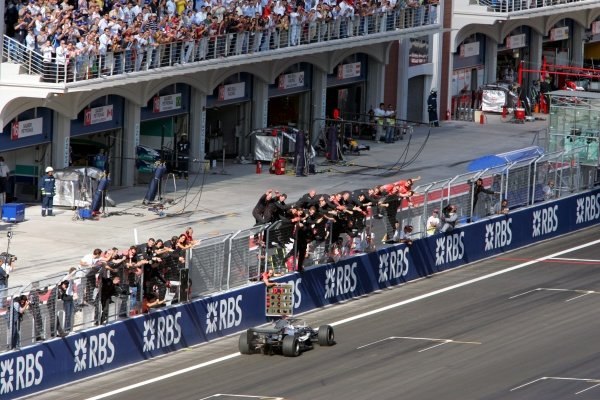 Race winner Kimi Raikkonen (FIN) McLaren Mercedes MP4/20 crosses the line at the end of the race.