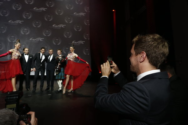 2013 FIA Gala Dinner and Awards. Paris, France. Friday 6th December 2013. Sebastian Vettel takes a picture of World Endurance Champions Loic Duval, Allan McNish and Tom Kristensen. World Copyright & Mandatory Credit: FIA. ref: Digital Image 11243647043_71c315e27e_o