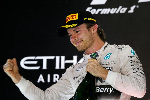 Yas Marina Circuit, Abu Dhabi, United Arab Emirates. Sunday 29 November 2015. Nico Rosberg, Mercedes AMG, 1st Position, celebrates victory on the podium. World Copyright: Charles Coates/LAT Photographic ref: Digital Image _99O2758