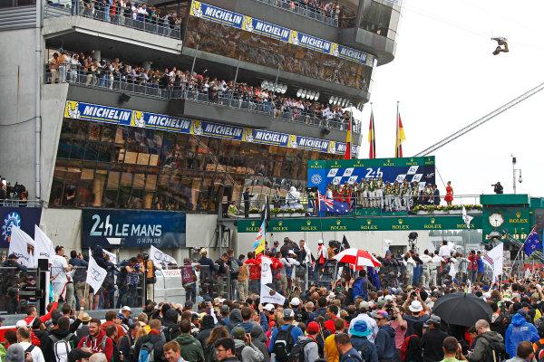 2015 Le Mans 24 Hours. Circuit de la Sarthe, Le Mans, France. Sunday 14 June 2015. Porsche Team (Porsche 919 Hybrid - LMP1), Nico Hulkenberg, Earl Bamber, Nick Tandy, Porsche Team (Porsche 919 Hybrid - LMP1), Timo Bernhard, Mark Webber, Brendon Hartley & Audi Sport Team Joest (Audi R18 E-Tron Quattro - LMP1), Marcel Fassler, Andre Lotterer, Benoit Treluyer, on the podium Photo:  Sam Bloxham/LAT Photographic. ref: Digital Image _G7C0027