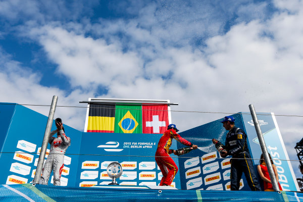 2014/2015 FIA Formula E Championship. Berlin ePrix, Berlin Tempelhof Airport, Germany. Saturday 23 May 2015 Podium. 1st, Lucas di Grassi (BRA)/Audi Abt Sport - Spark-Renault SRT_01E, 2nd, Jerome D'Ambrosio (BEL)/Dragon Racing - Spark-Renault SRT_01E and 3rd, Sebastien Buemi (SWI)/E.dams Renault - Spark-Renault SRT_01E. Photo: Zak Mauger/LAT/Formula E ref: Digital Image _L0U9708