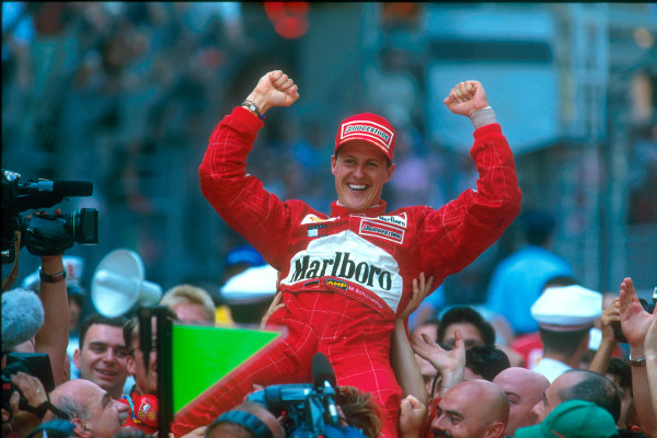 Monte Carlo, Monaco. 29th May 2001. Michael Schumacher, Ferrari F2001, is lifted jubilantly above the heads of his Ferrari team.World Copyright: Steven Tee/LAT Photographic ref: 35mm Priority Image 01MON08