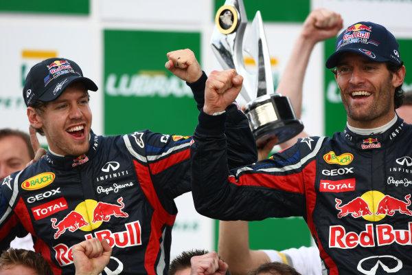 Interlagos, Sao Paulo, Brazil.27th November 2011.Sebastian Vettel, Red Bull Racing RB7 Renault, 2nd position, and Mark Webber, Red Bull Racing RB7 Renault, 1st position. Portrait. Finish. World Copyright:Andy Hone/LAT Photographicref: Digital Image  CSP20805