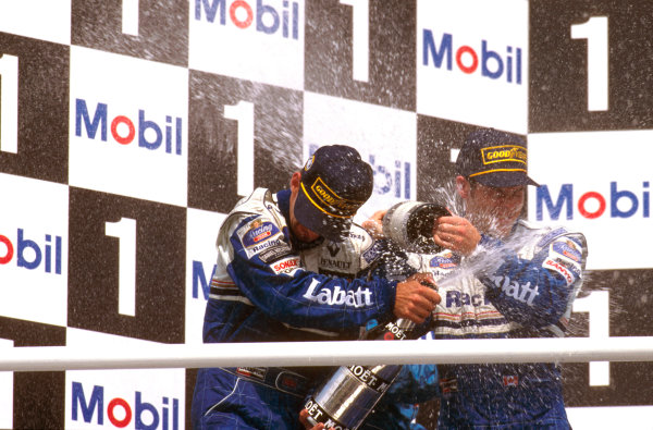 Hockenheim, German.26-28 July 1996.Damon Hill (Williams Renault) celebrates on the podium with teammate Villeneuve.Ref-96 GER 02.World Copyright - LAT Photographic