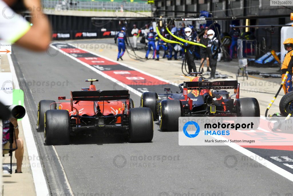 Charles Leclerc, Ferrari SF90 and Max Verstappen, Red Bull Racing RB15 wheel to wheel in the pit lane