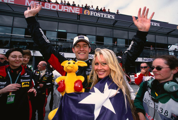 2002 Australian Grand PrixMelbourne Park, Australia. 1st - 3rd March 2002.Mark Webber, KL Minardi Asiatech PS02, celebrates finishing in 5th position on his grand prix debut and on home soil. Photo: Steven Tee/LAT Photographicref: 35mm Image A18