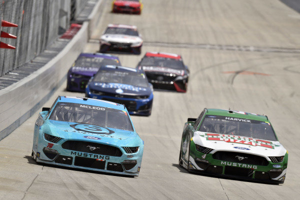 #78: B.J. McLeod, Live Fast Motorsports, Ford Mustang Surface Sunscreen/Koolbox ICE and #4: Kevin Harvick, Stewart-Haas Racing, Ford Mustang Hunt Brothers Pizza
