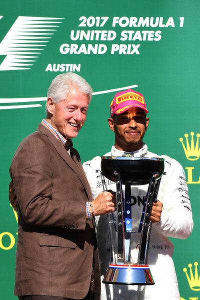 Race winner Lewis Hamilton (GBR) Mercedes AMG F1 celebrates on the podium with Bill Clinton (USA) and the trophy at Formula One World Championship, Rd17, United States Grand Prix, Race, Circuit of the Americas, Austin, Texas, USA, Sunday 22 October 2017. BEST IMAGE