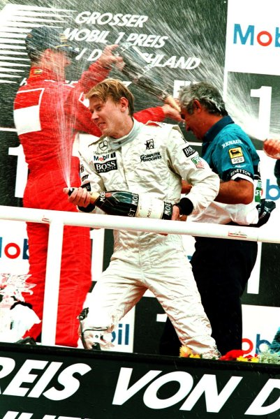 1997 German Grand Prix.Hockenheim, Germany.25-27 July 1997Michael Schumacher (Ferrari) and Mika Hakkinen (McLaren Mercedes-Benz) celebrate after finishing in 2nd and 3rd positions respectively.World Copyright - LAT Photographic