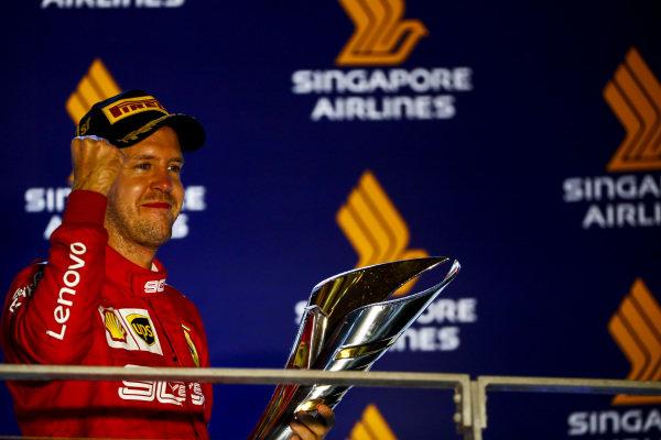 Race winner Sebastian Vettel, Ferrari celebrates n the podium with the trophy