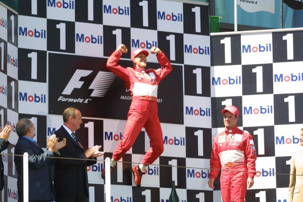 2001 French Grand Prix - RaceMagny-Cours, France. 1st July 2001race winner Michael Schumacher, Ferrari F2001, leaps in the air to celebrate his 50th ever GP win.World Copyright - LAT Photographicref: 8 9 MB Digital File only