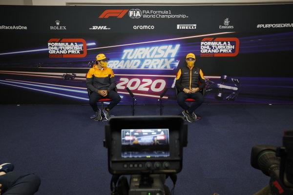 Carlos Sainz, McLaren, and Lando Norris, McLaren, in the press conference
