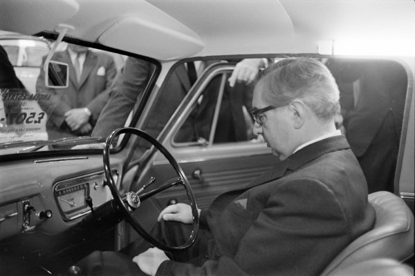 Deputy Prime Minister George Brown sits in the driver's seat of a Ford Anglia 105E.