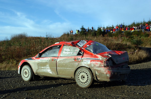 2002 World Rally Championship.Network Q Rally of Great Britain, Cardiff. November 14-17. Justin Dale drives his battered Mitsubishi through Stage 3 after a roll. He had just stopped to top up the water as the car was overheating.Photo: Ralph Hardwick/LAT