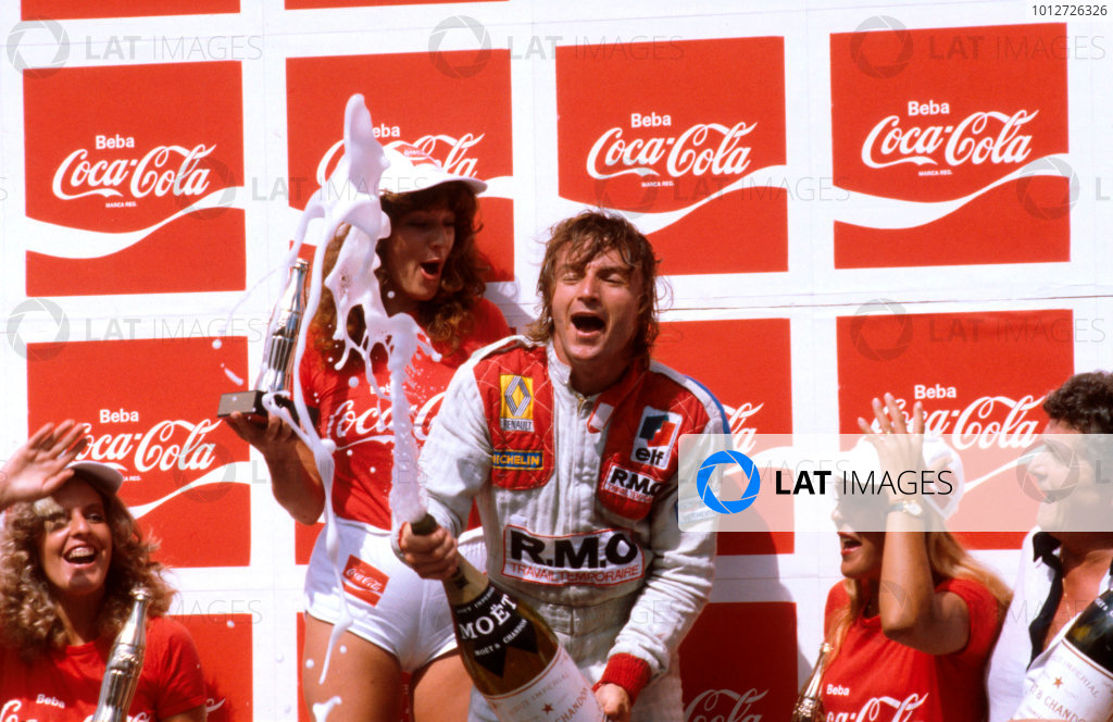 1980 Brazilian Grand Prix.Interlagos, Sao Paulo, Brazil.25-27 January 1980.Rene Arnoux (Equipe Renault) 1st position celebrates on the podium.Ref-80 BRA 03.World Copyright - LAT Photographic