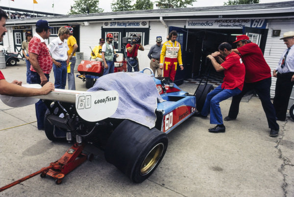 Gordon Smiley's damaged Patrick Racing Wildcat Mk8 Cosworth is returned to the pits.