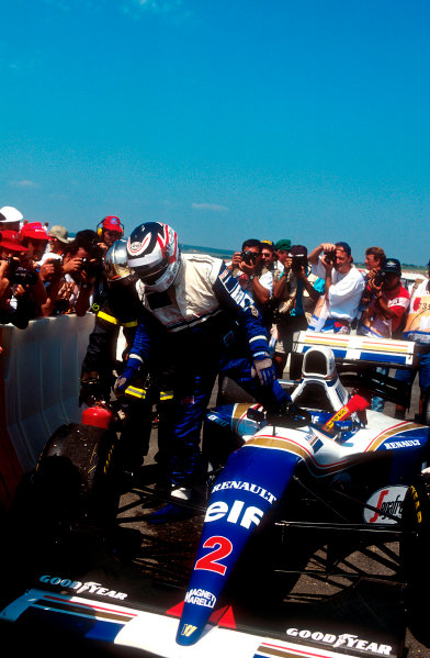 1994 French Grand Prix.Magny-Cours, France.30/6-2/7 1994.Nigel Mansell (Williams FW16 Renault) steps out of his car in parc ferme, after just qualifying on the front row on his return to formula one.Ref-94 FRA 07.World Copyright - LAT Photographic