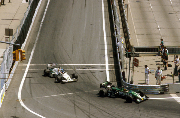 1983 United States Grand Prix East.Detroit, Michigan, USA.3-5 June 1983.Michele Alboreto (Tyrrell 011 Ford) 1st position with Keke Rosberg (Williams FW08C Ford) 2nd position behind.Ref-83 USA 08.World Copyright - LAT Photographic