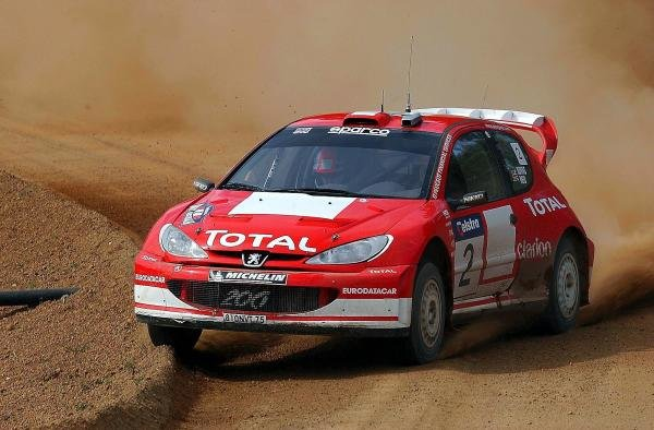 Richard Burns (GBR) / Robert Reid (GBR) Peugeot 206 WRC.