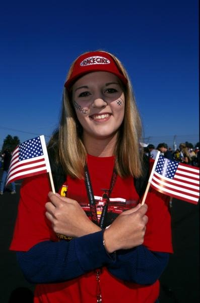 """Everybody loves the """"race girl"""" American Grand Prix, Indianapolis, USA, 30 September 2001."""