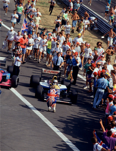 2003 Racing Past. . Exhibition1992 Hungarian Grand Prix, Hungaroring. Nigel Mansell (Williams FW14B-Renault), is greeted by fans after winning the World Championship.World Copyright - LAT PhotographicExhibition ref: a046