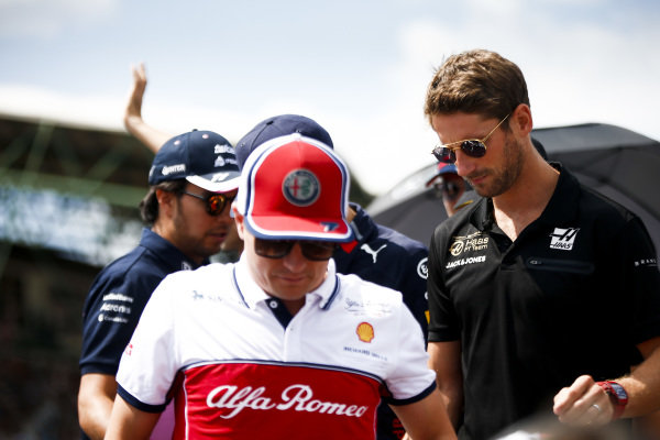 Kimi Raikkonen, Alfa Romeo Racing, and Romain Grosjean, Haas F1, in the drivers parade