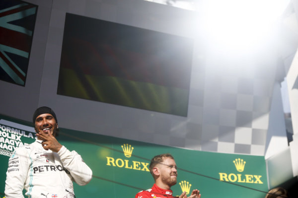Lewis Hamilton, Mercedes AMG F1, 1st position, and Sebastian Vettel, Ferrari, 3rd position, on the podium